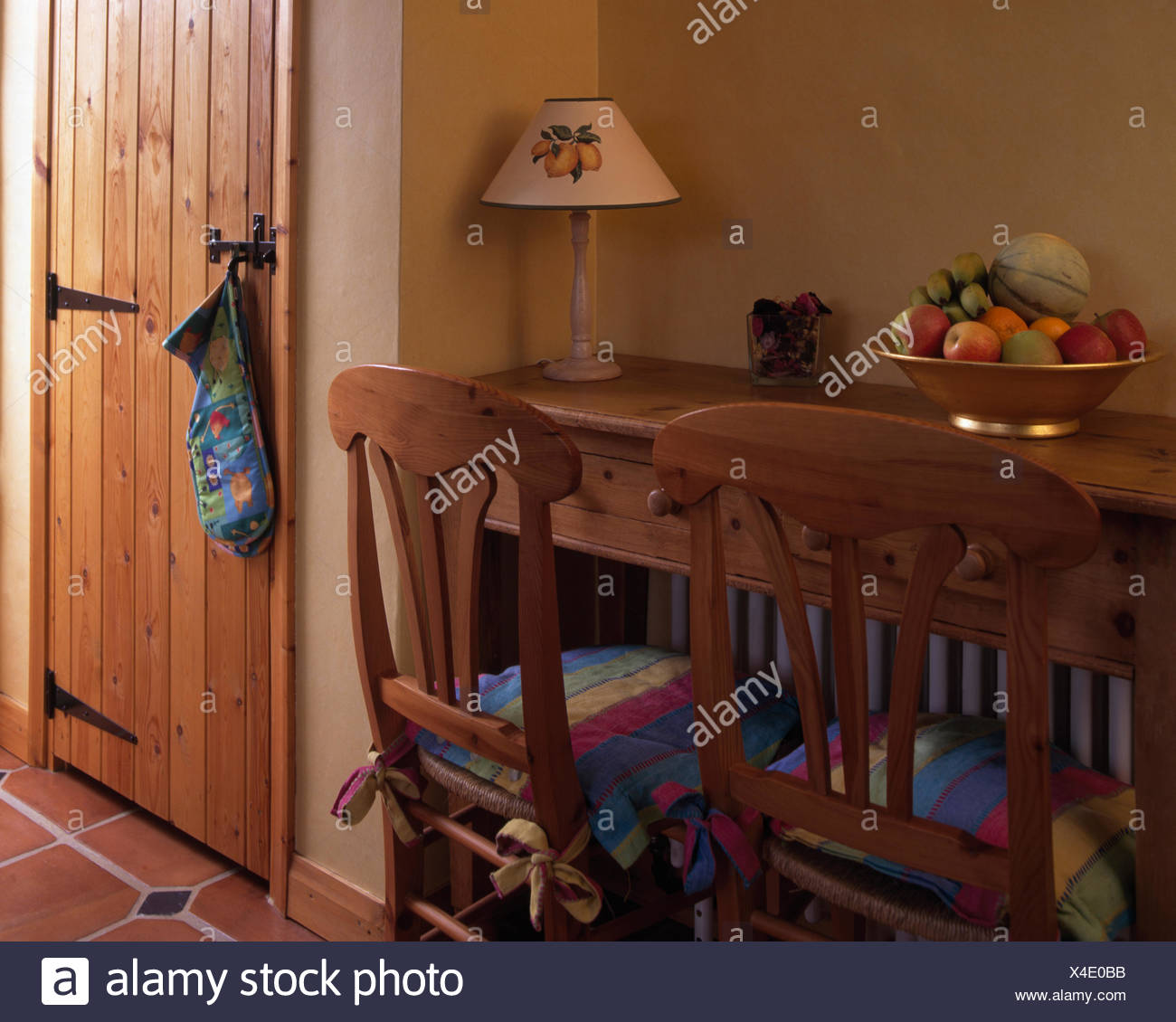 Simple Wooden Chairs And Small Dining Table In A Cottage Dining Room Stock Photo Alamy