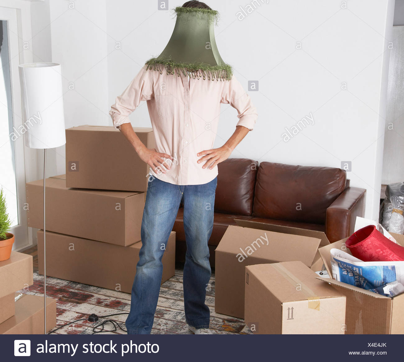 Lamp Shade On Head : Man with lamp shade on head in home cardboard boxes