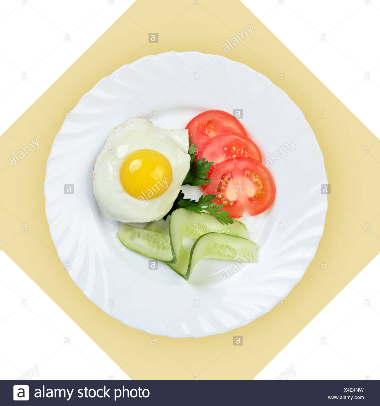 Dish of scrambled egg with vegetables on white plate. - Stock Image