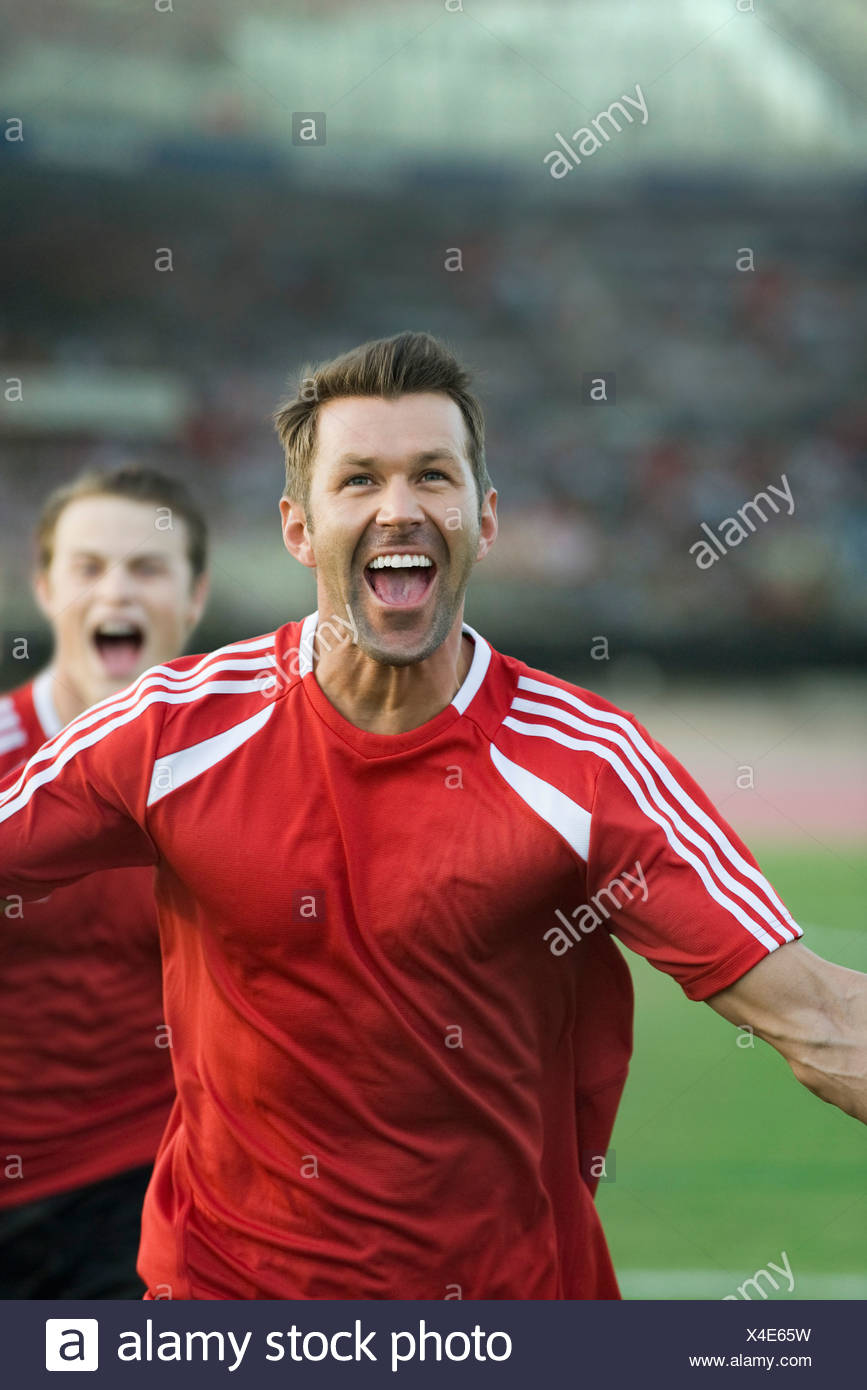 Soccer players shouting in victory - Stock Image