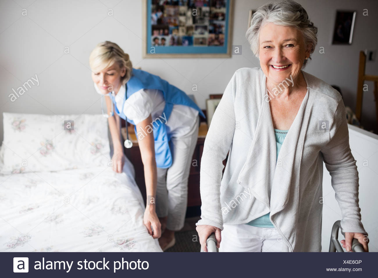 Nurse and senior woman are posing - Stock Image