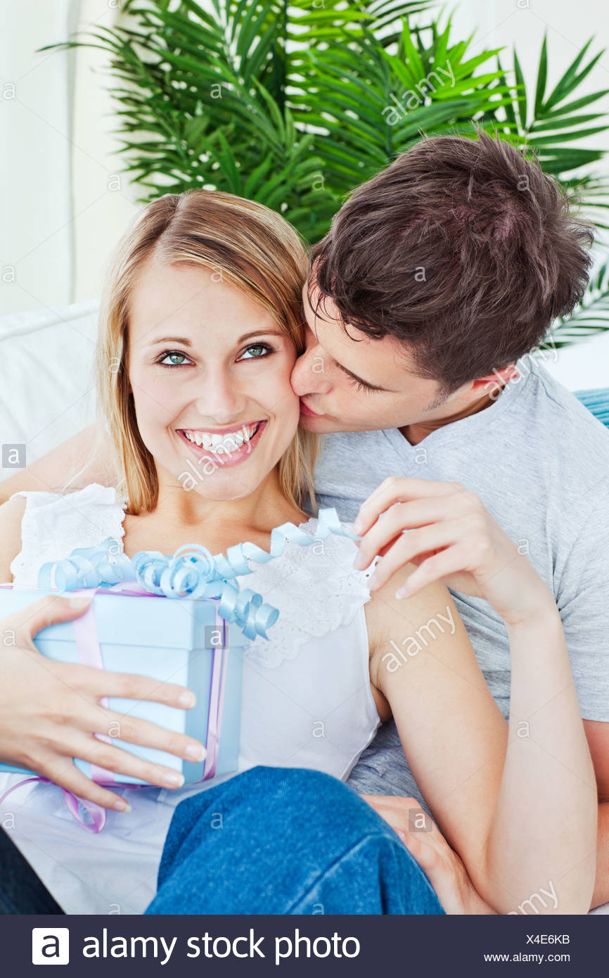 Pleased woman receive a present from her boyfriend - Stock Image