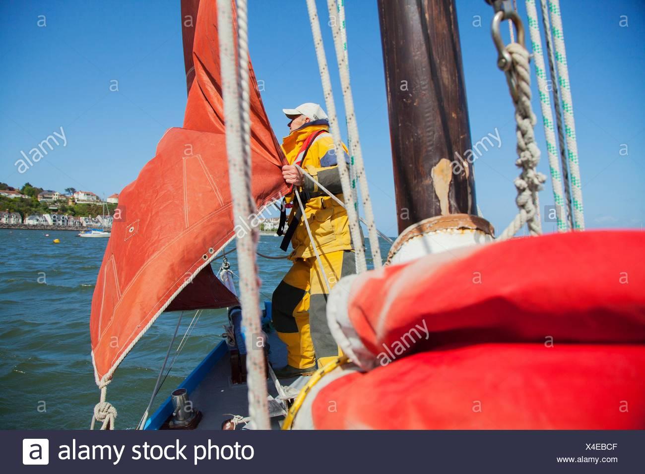 Senior man on sailing boat - Stock Image