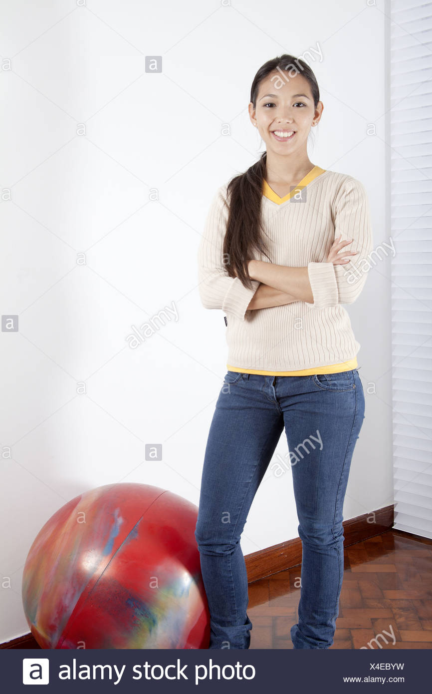 Young woman with arms crossed - Stock Image
