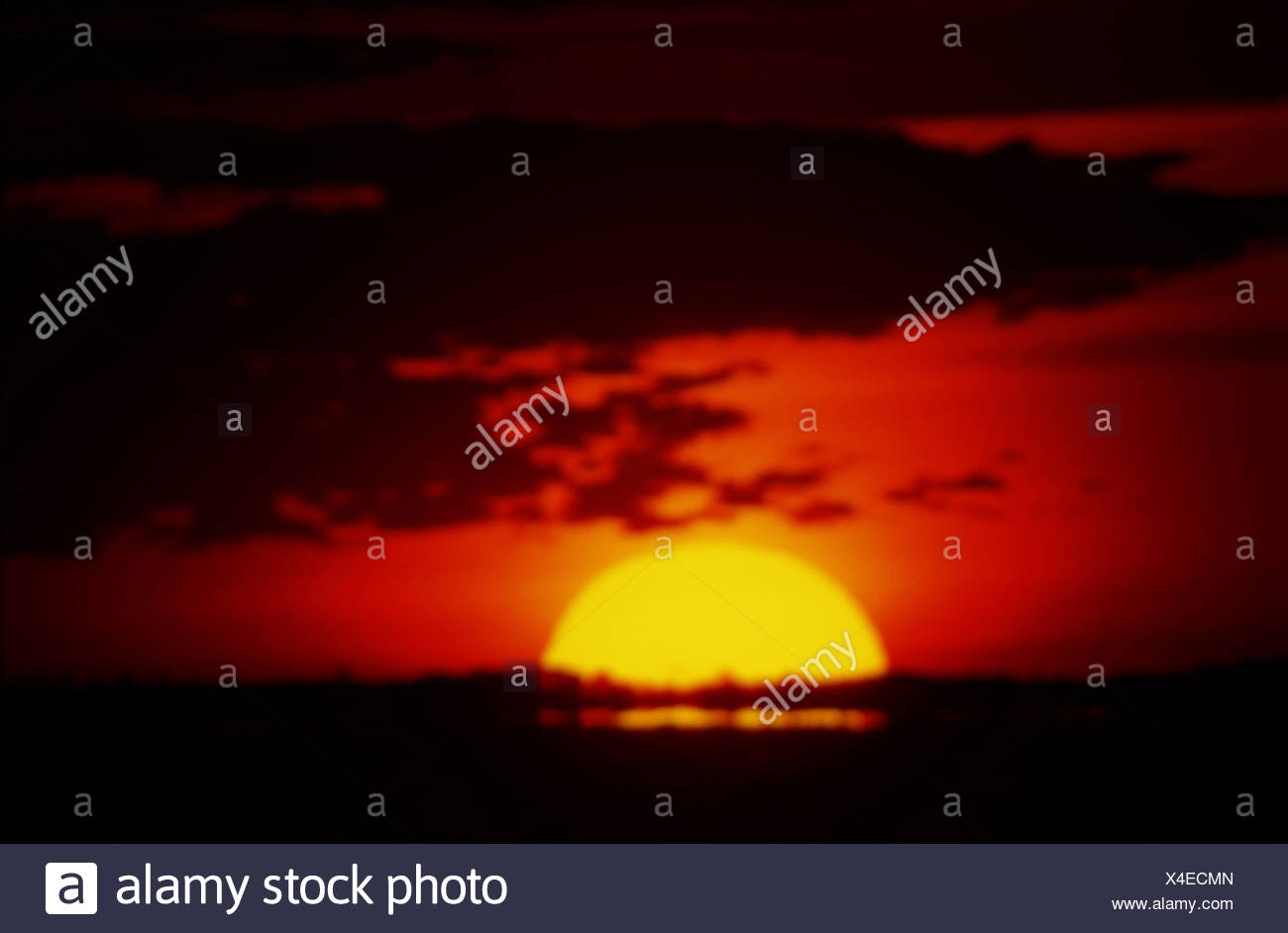 BRIGHT RED SUNSET - Stock Image