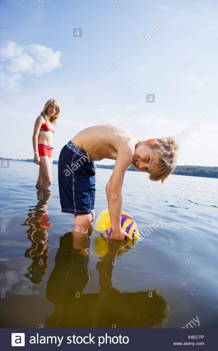 A young boy looking mischievous - Stock Image