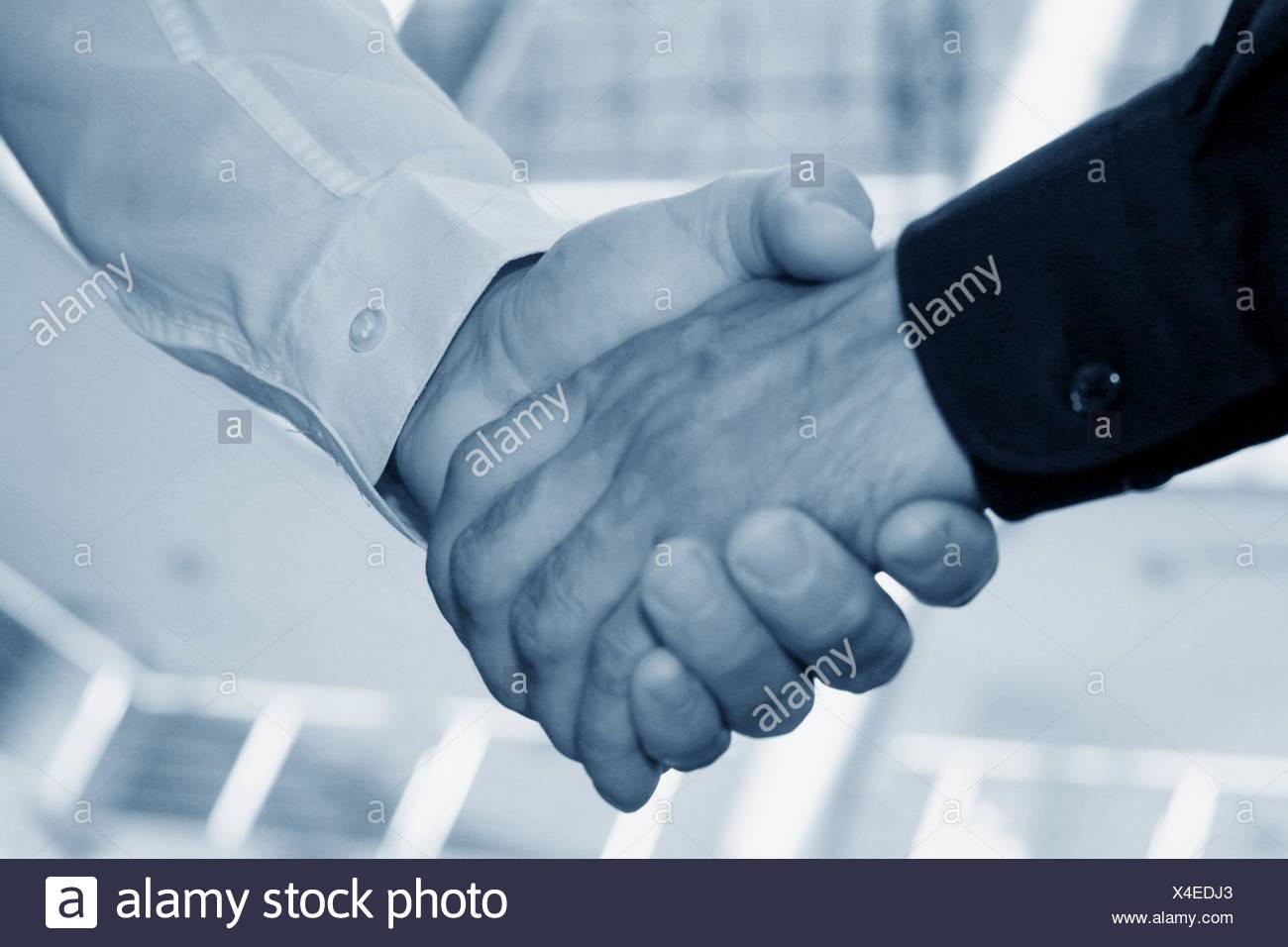 2 black men shaking hands stock photos 2 black men shaking hands