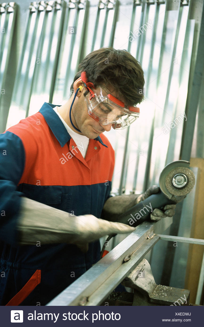 Manual worker sanding - Stock Image