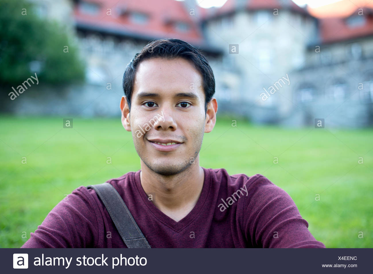 Head and shoulders portrait of a young man - Stock Image