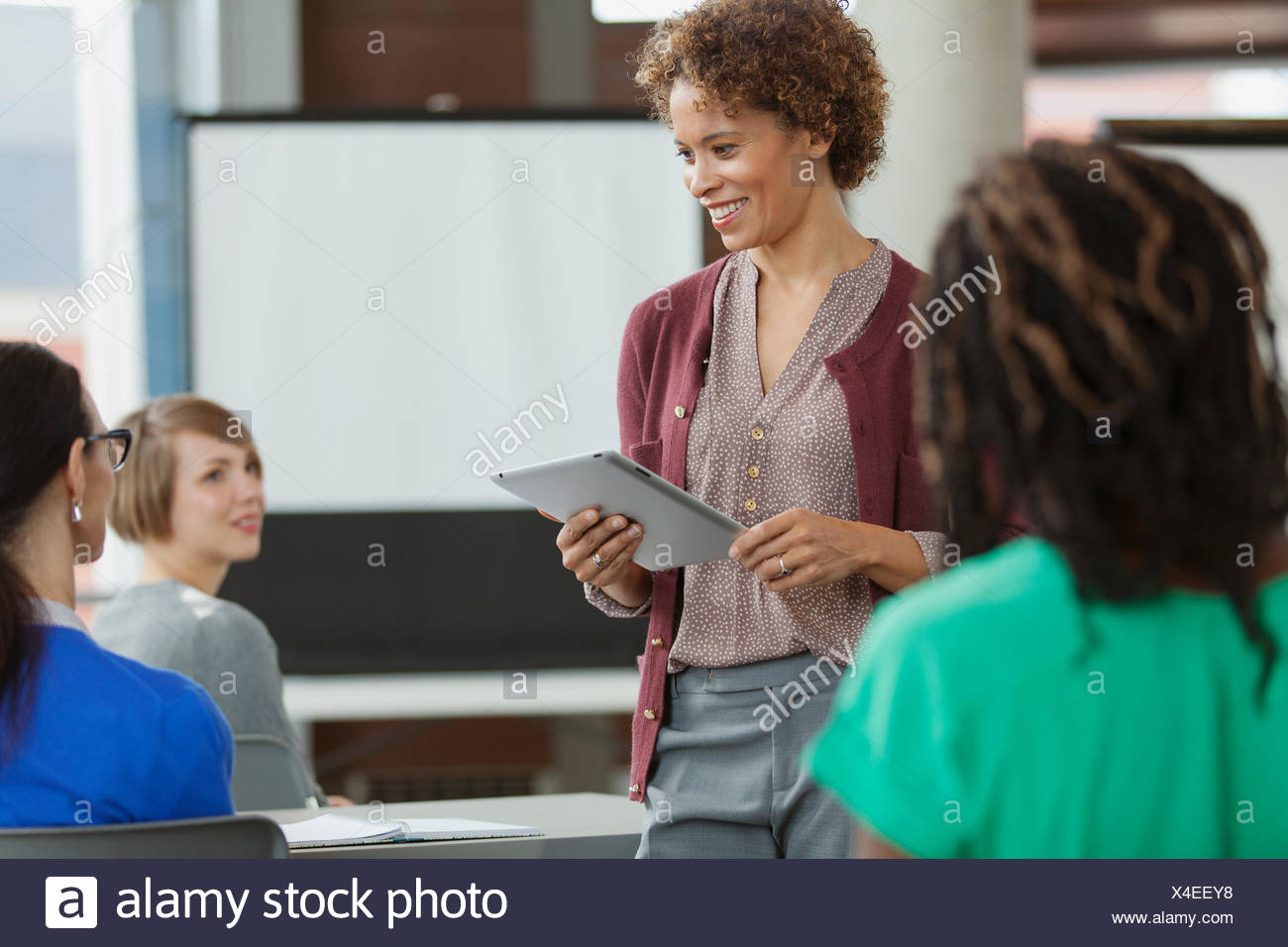 Woman doing business presentation with tablet computer. - Stock Image