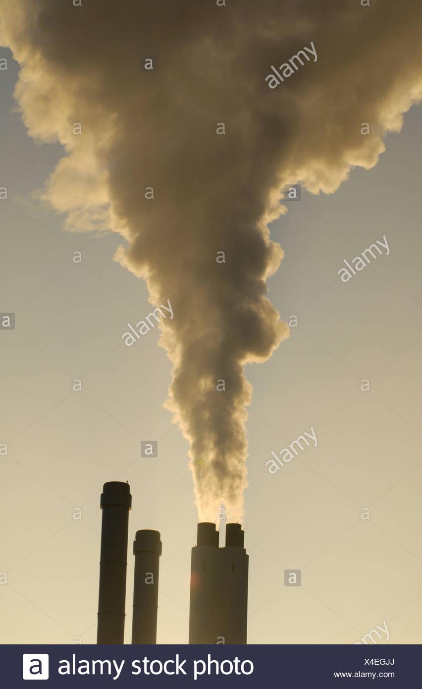 smouldering smokestak - Stock Image