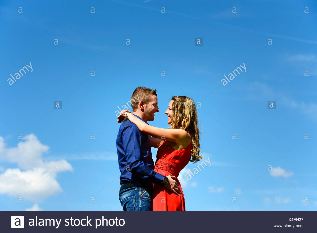 Lovers against a blue sky, Austria - Stock Image