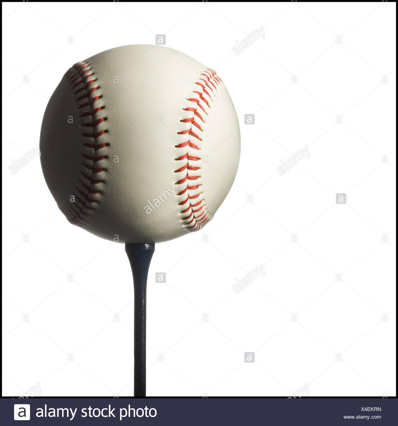 baseball on a golf tee - Stock Image