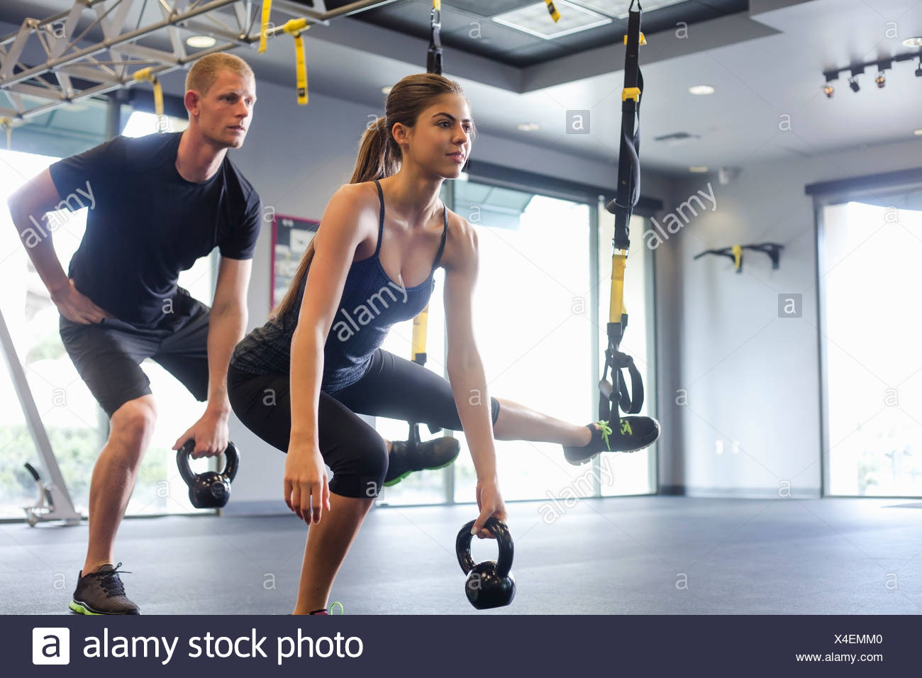 Couple working out with weights - Stock Image