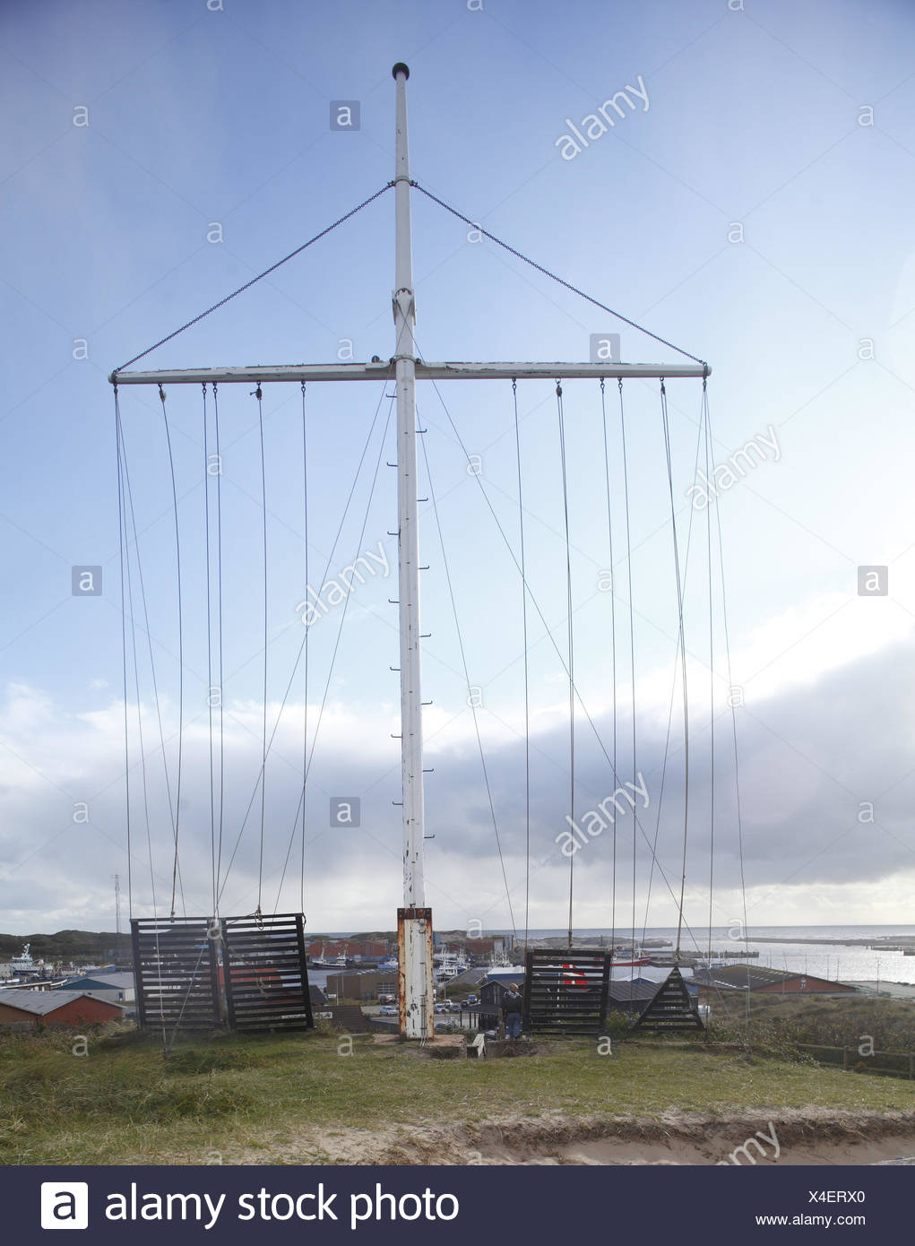 Denmark, Jutland, flagpole with view at the fishing port Hvide sand, - Stock Image