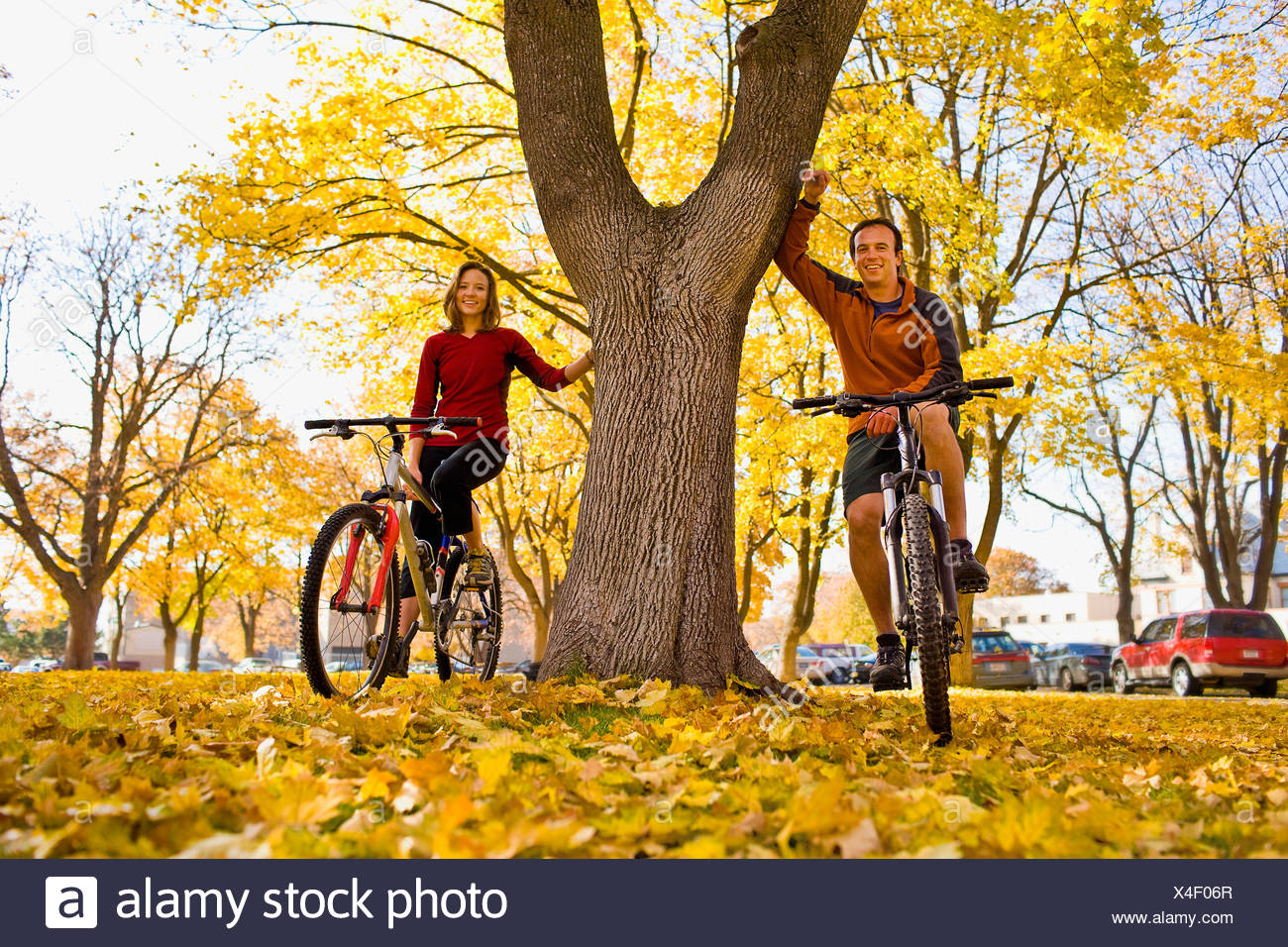 USA, Montana, Kalispell, Portrait of couple at bikes in park - Stock Image