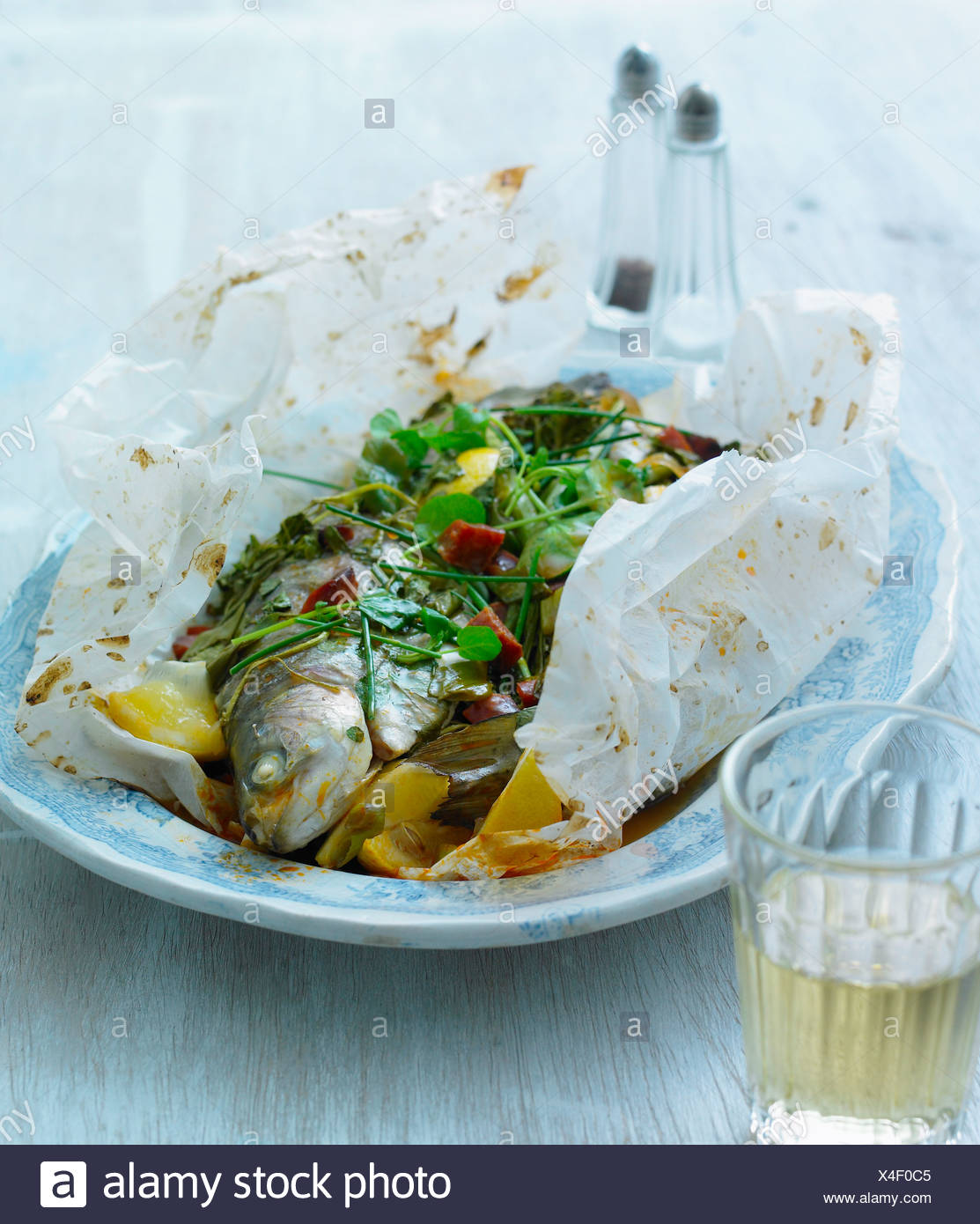 Baked trout with watercress, chorizo, garlic and wine - with recipe - Stock Image