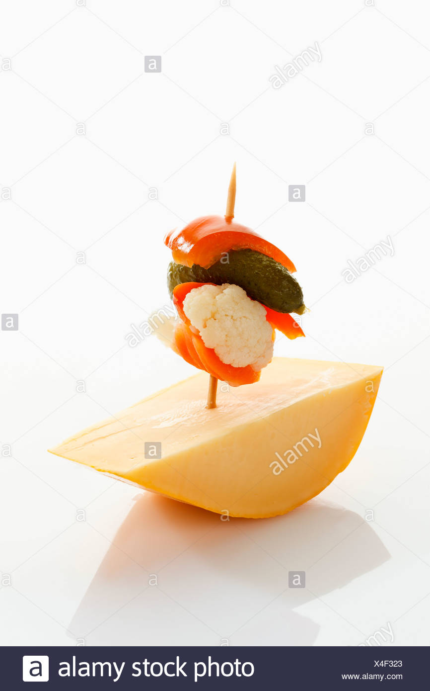 Preserved mixed pickles with cheese on white background - Stock Image