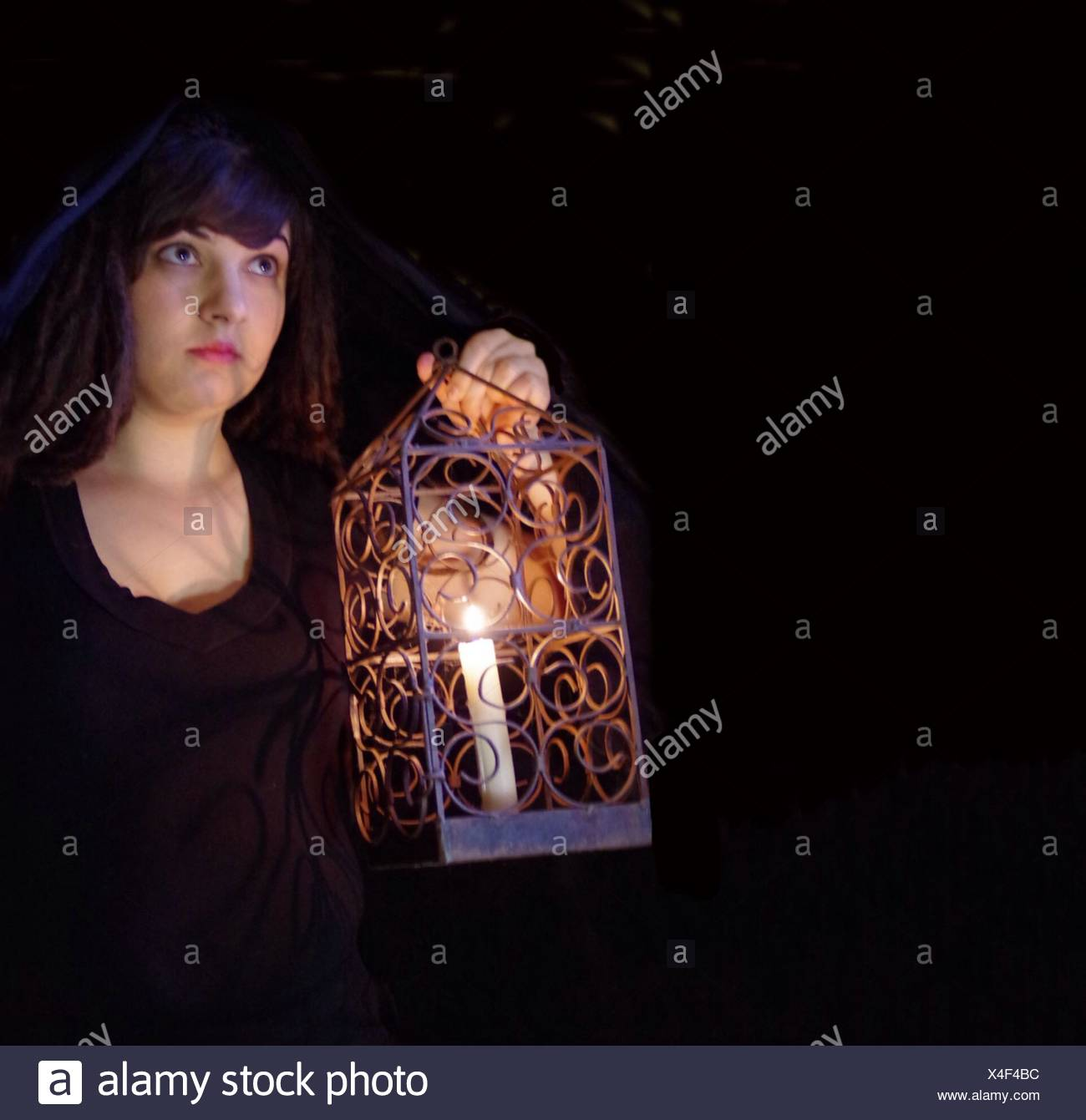 Young Woman With Lantern At Night - Stock Image
