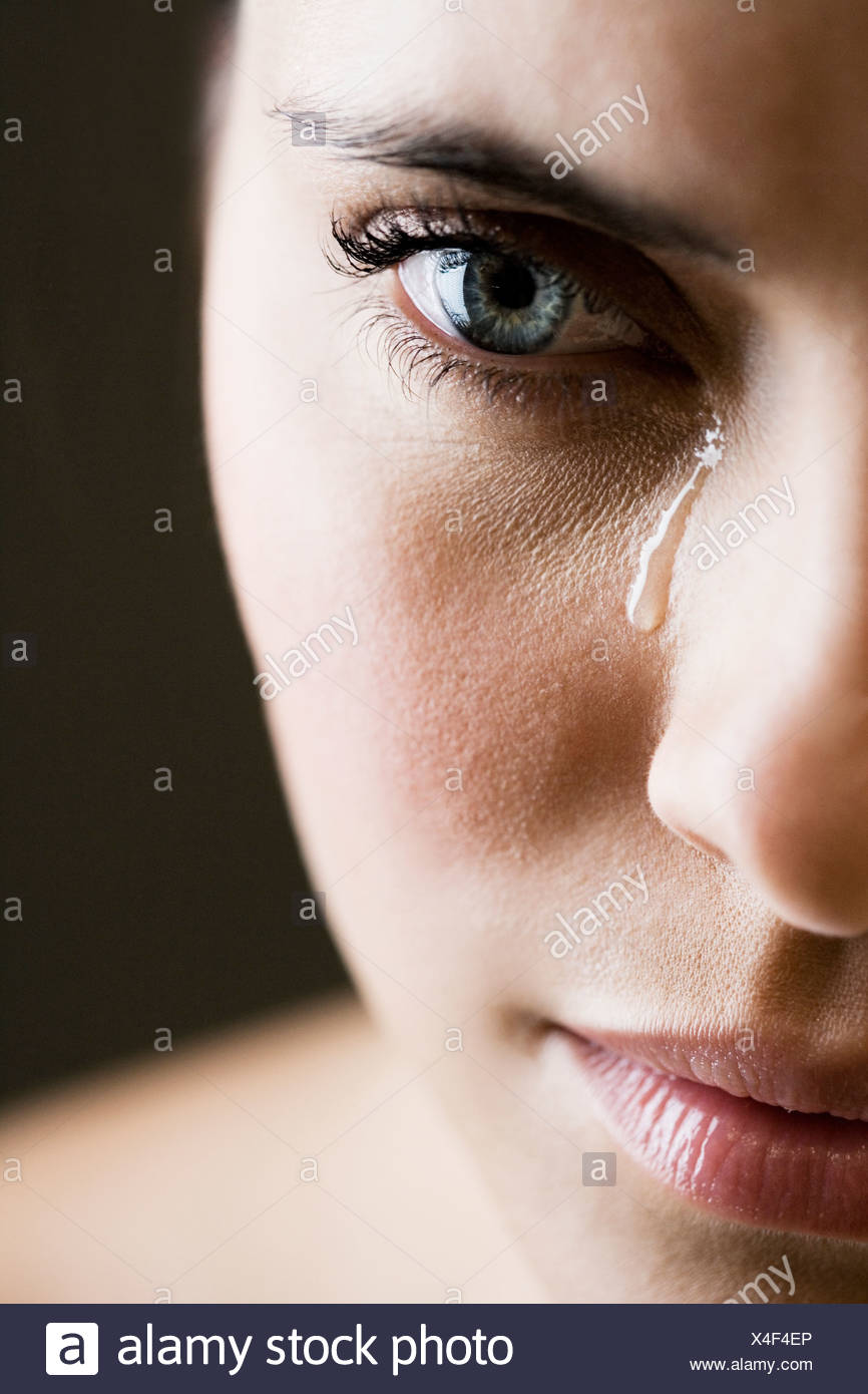 Close up of woman crying - Stock Image