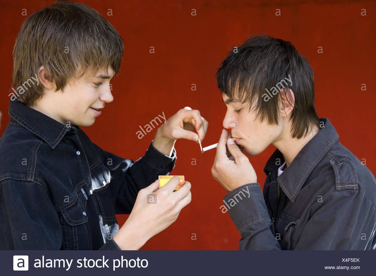 Teenagersboyscigarette smoke stock image