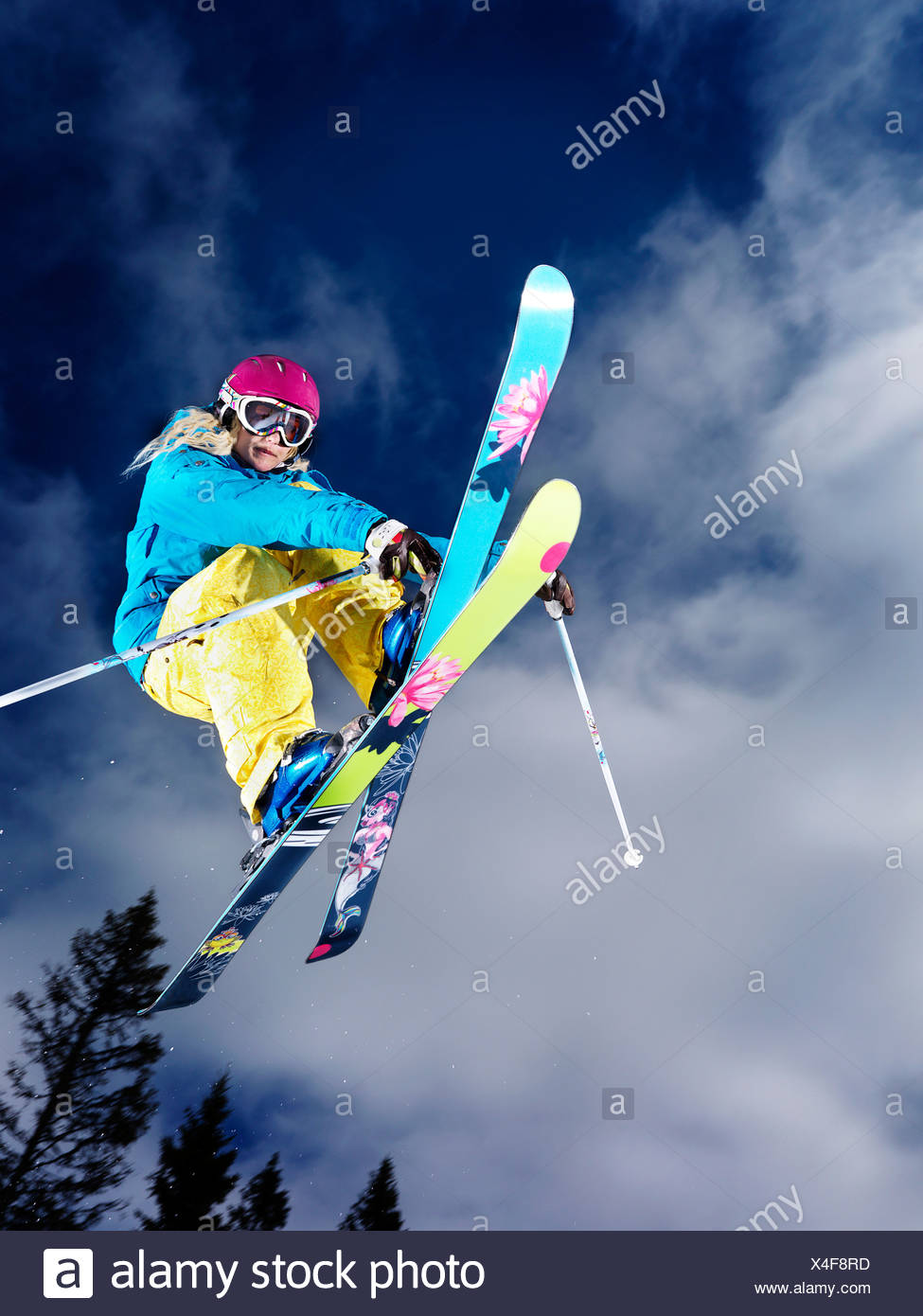 Girl doing a grab mid air. - Stock Image