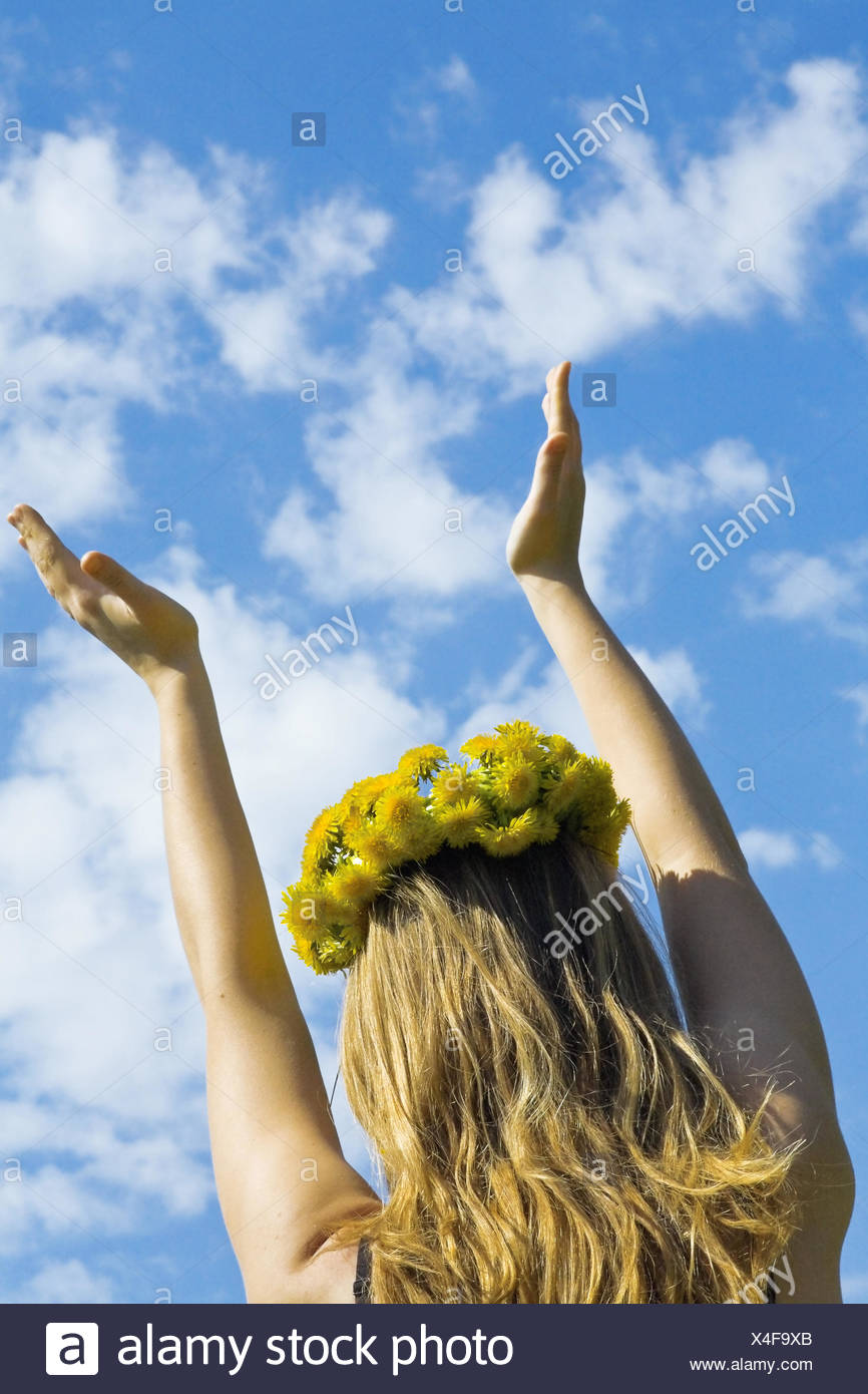 girl in a wreath from flowers - Stock Image