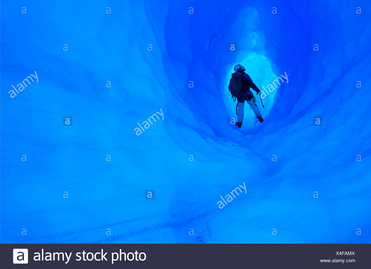 Ice climbing in an ice cave or glacier cave, Grey Glacier, Torres del Paine National Park, Chile - Stock Image