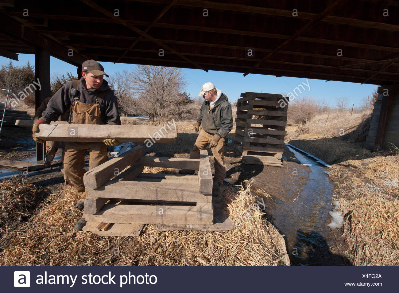 A crew works to prop a bridge up so that it can handle more weight. - Stock Image