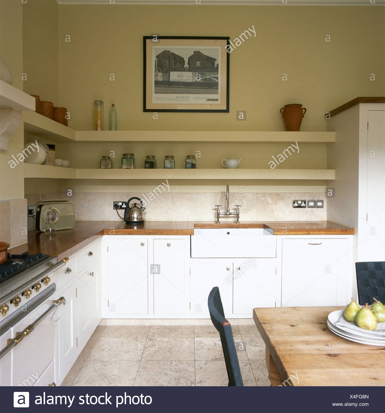 Kitchen Sink White Chairs Fridge And Vase On Table