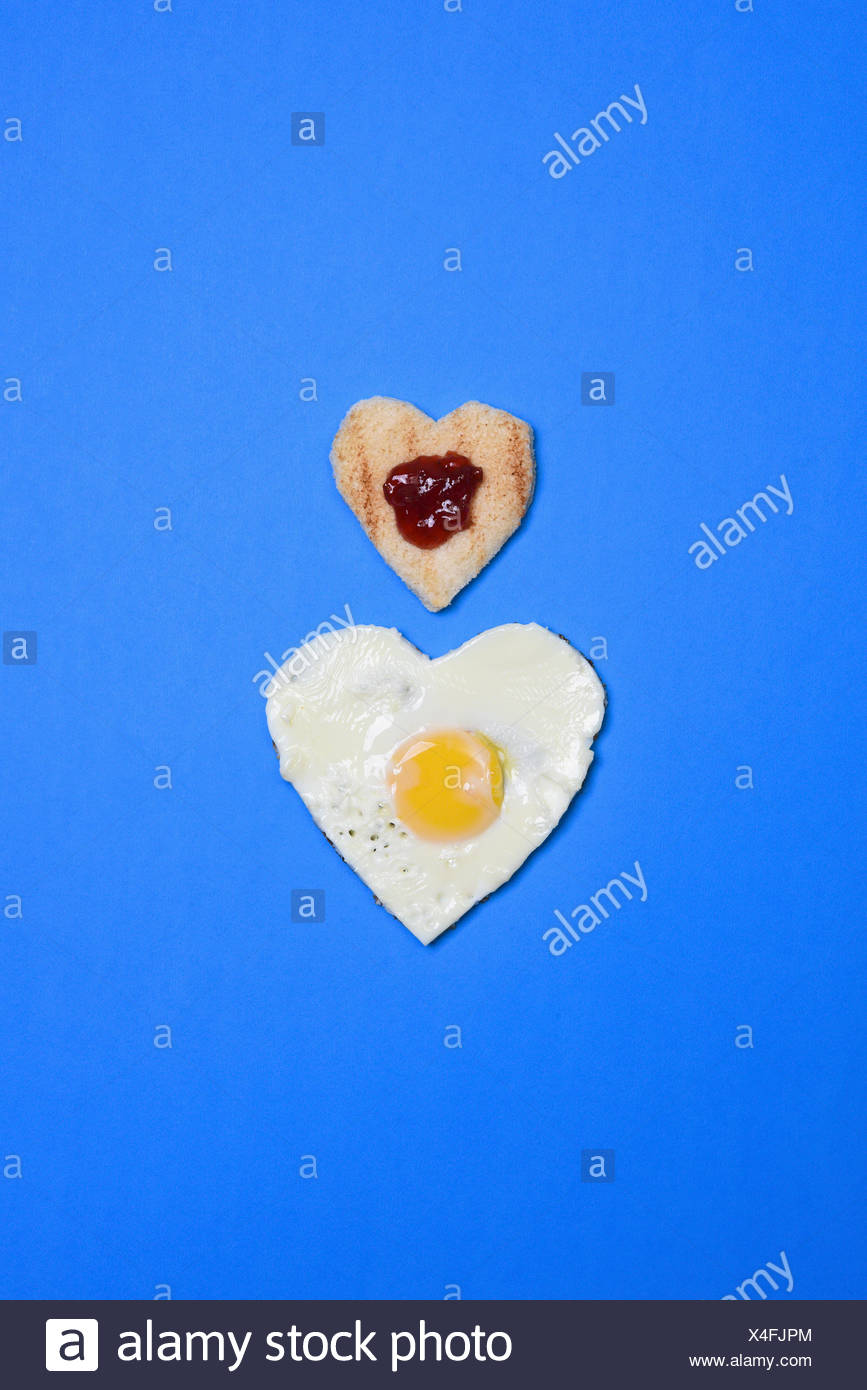 Two hearts made with bread, jam and egg - Stock Image