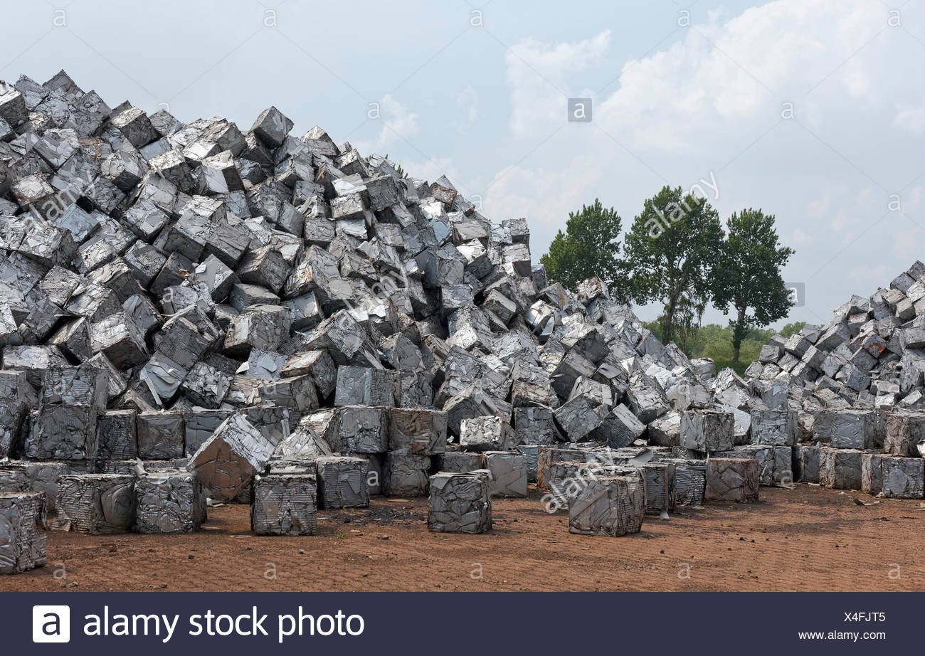 Mountain of scrap metal, pressed into cubes, metal waste from industrial production, Port of Duisburg, Duisport, Ruhr district - Stock Image