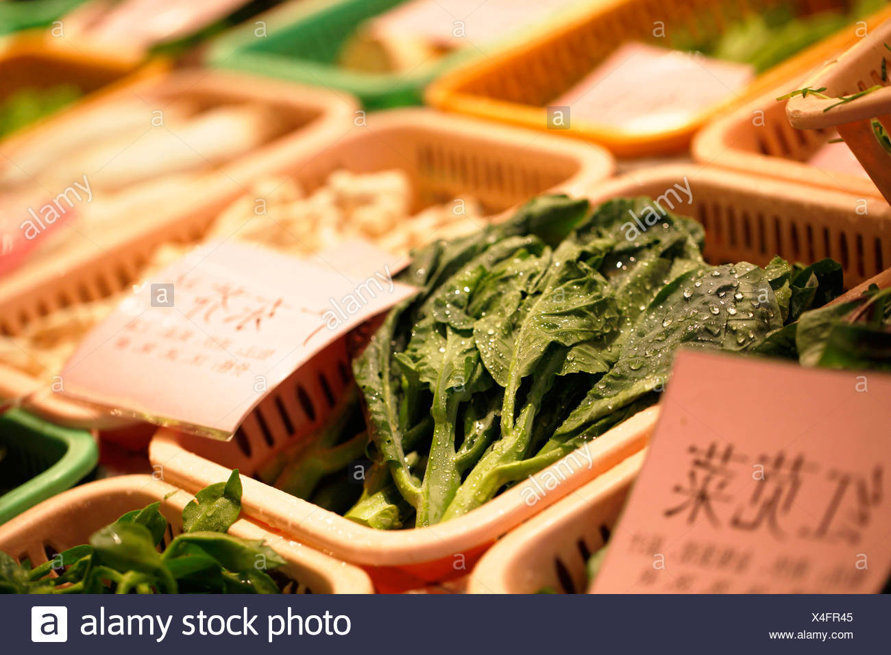 Vegetables displayed at a restaurant, Xiamen, also known as Amoy, Fujian province, China, Asia - Stock Image
