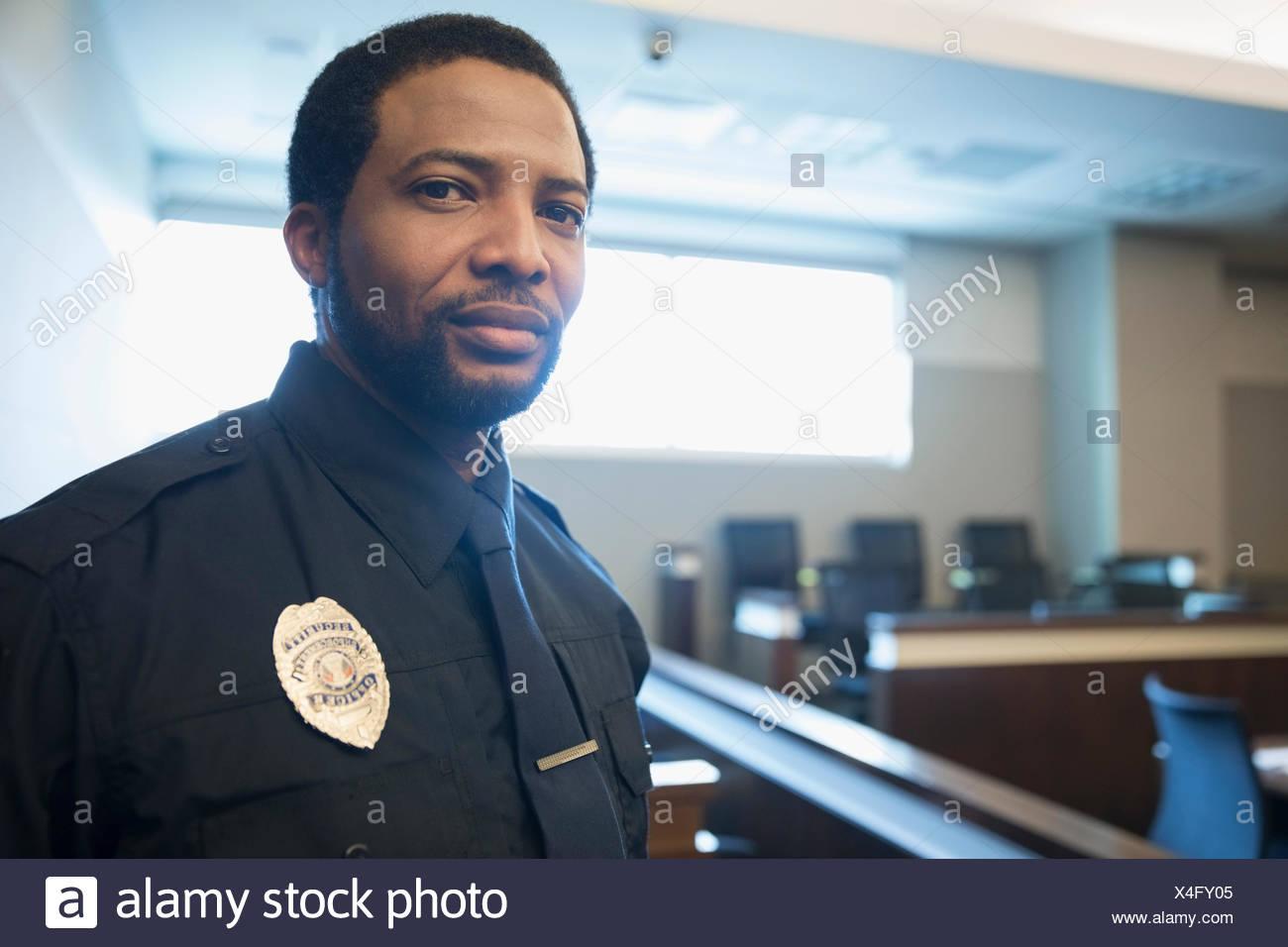 Portrait confident male bailiff in courtroom - Stock Image