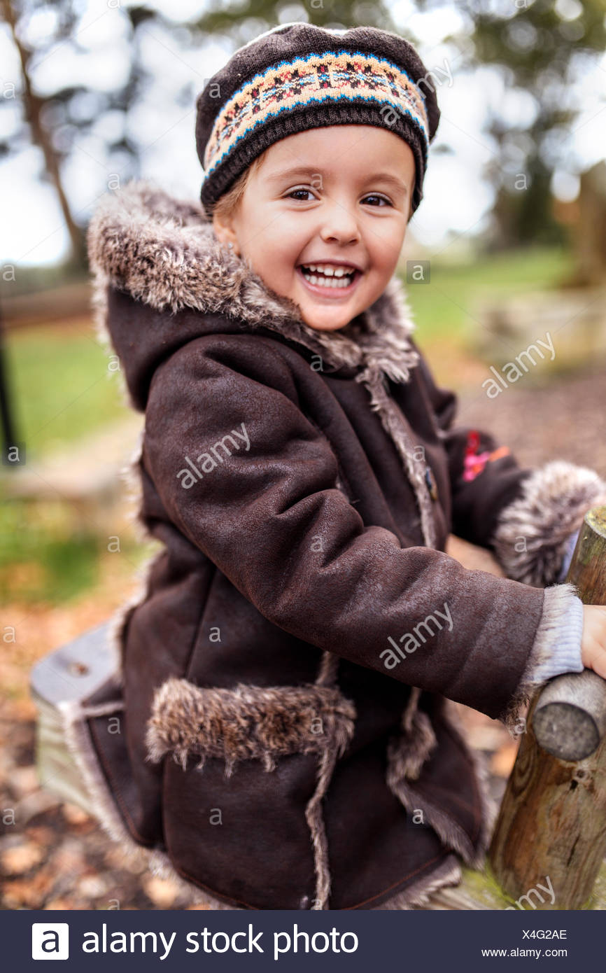 Portrait of happy little girl on a playground in autumn Stock Photo