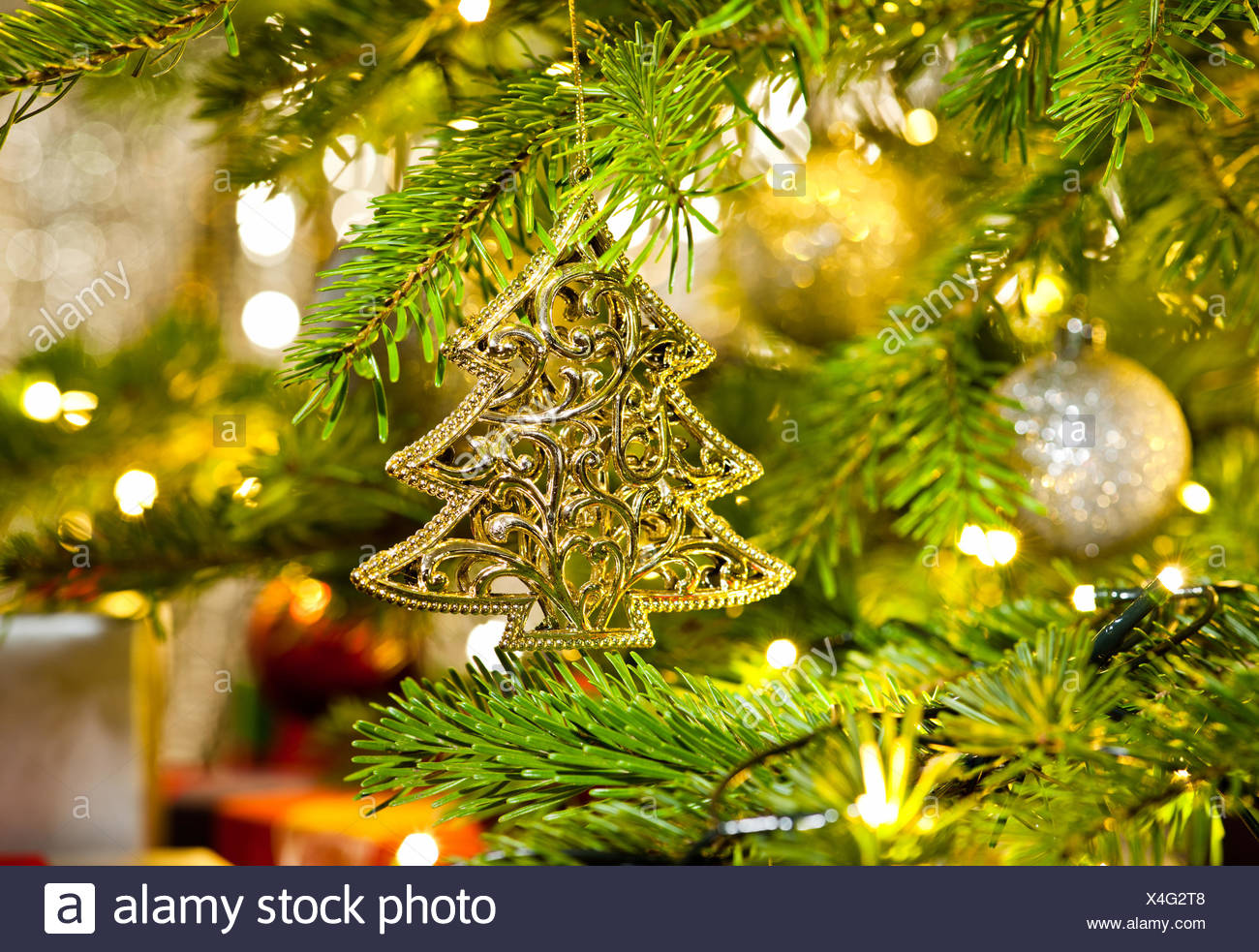 Xmas Ornament in a real Christmas tree in bright color Stock Photo ...