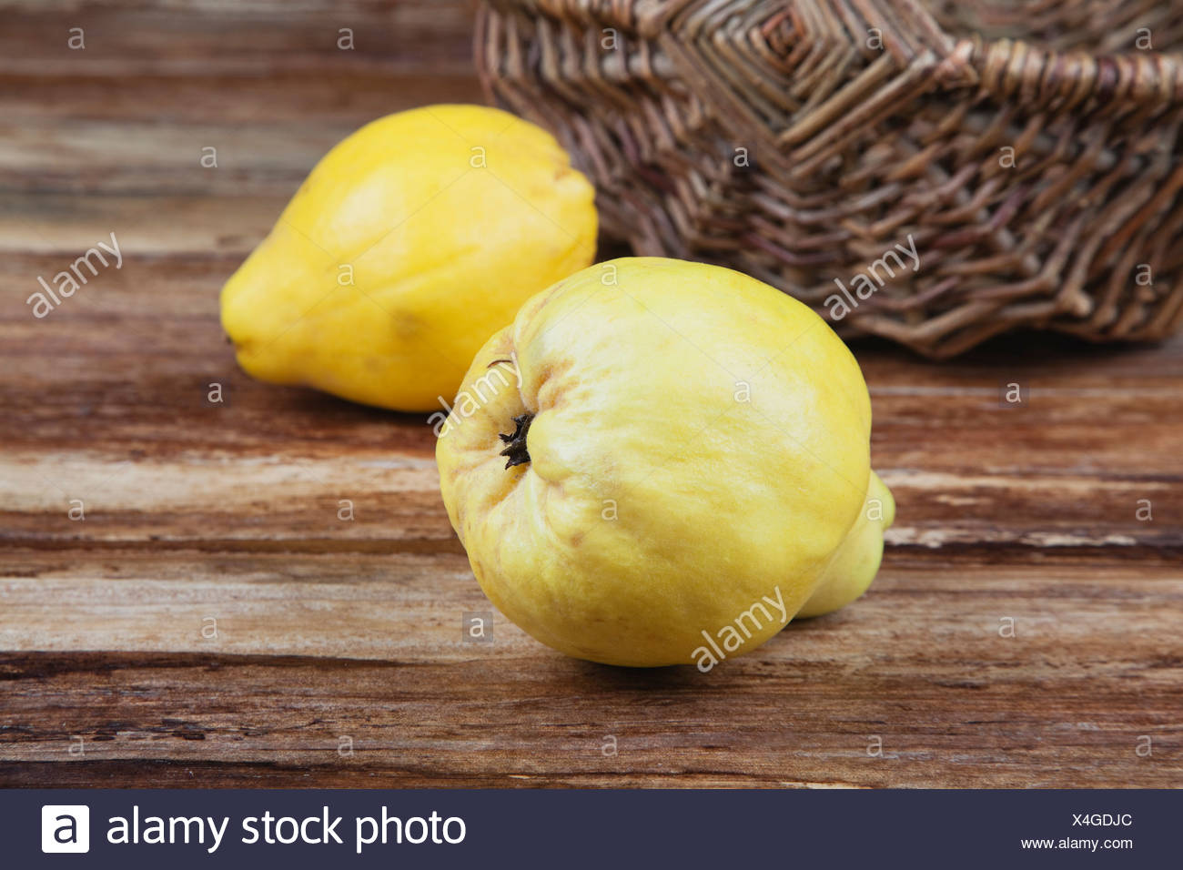 Quince on wooden table, close up Stock Photo