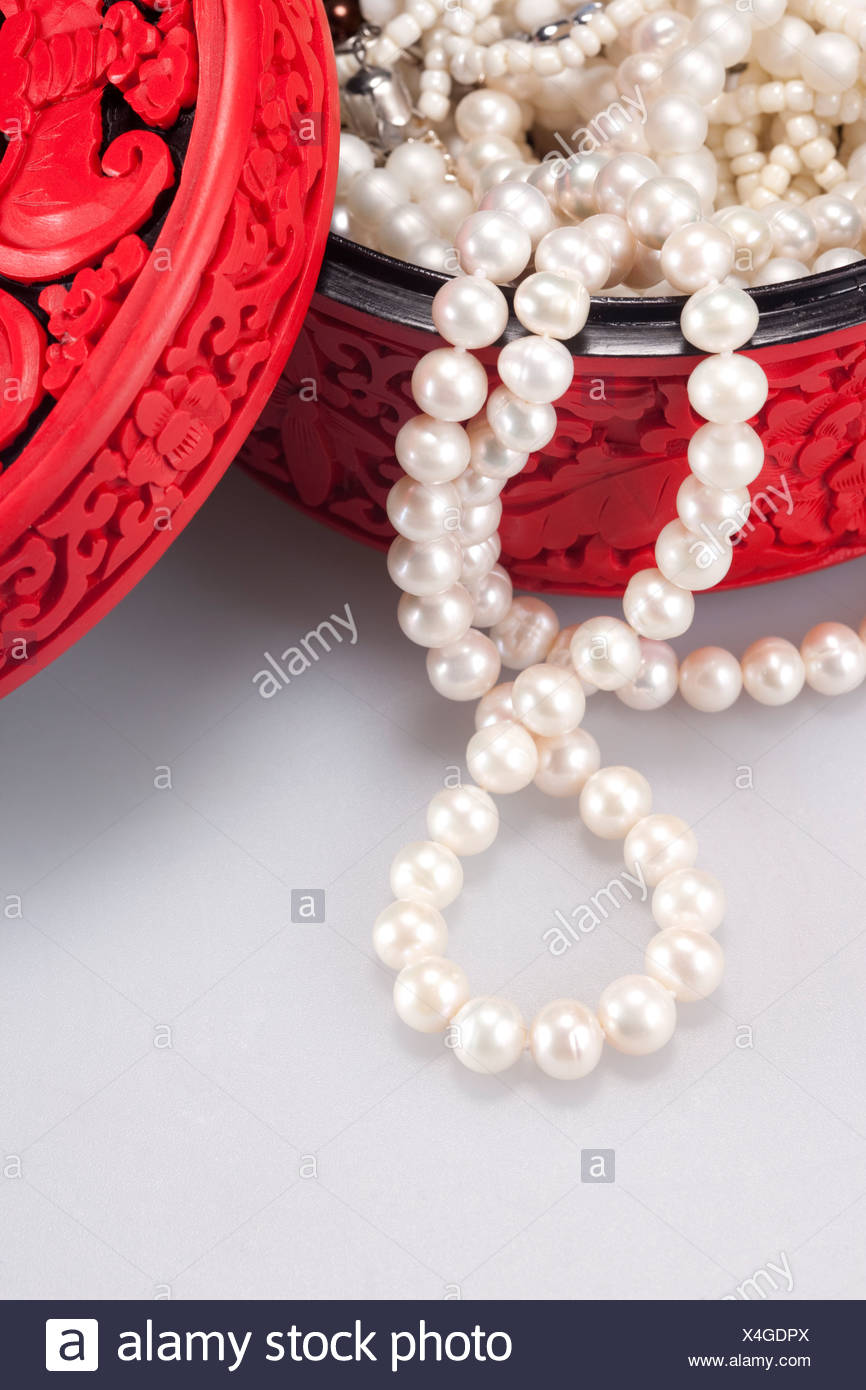 d02872ec9a9fe7 Close-Up of traditional Chinese longevity box with pearl necklace ...