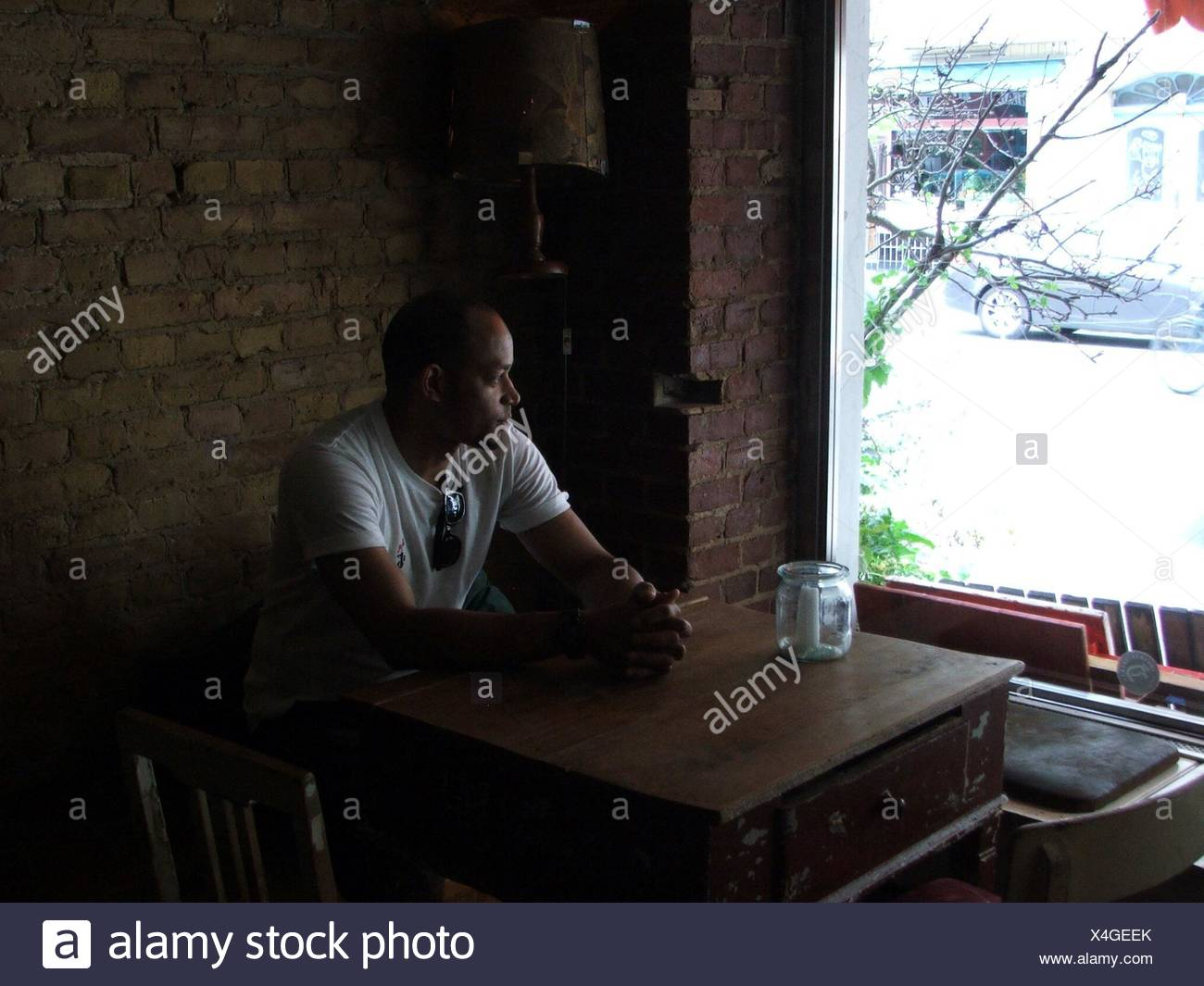 Man Sitting In Cafe - Stock Image