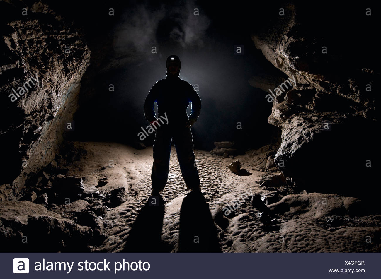 Man in a cave - Stock Image