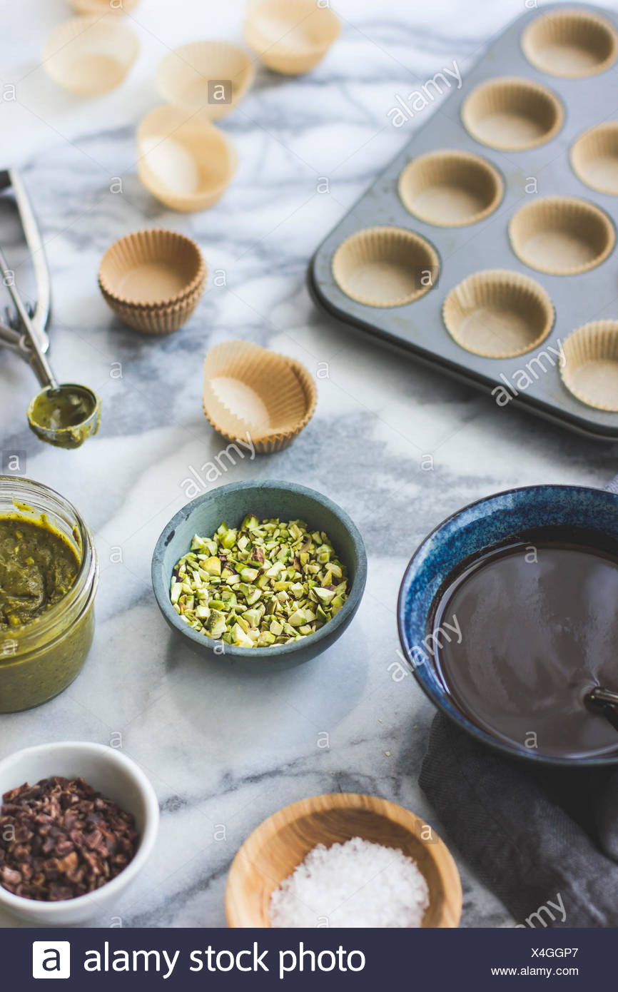 Salted chocolate pistachio butter cups ingredients. - Stock Image