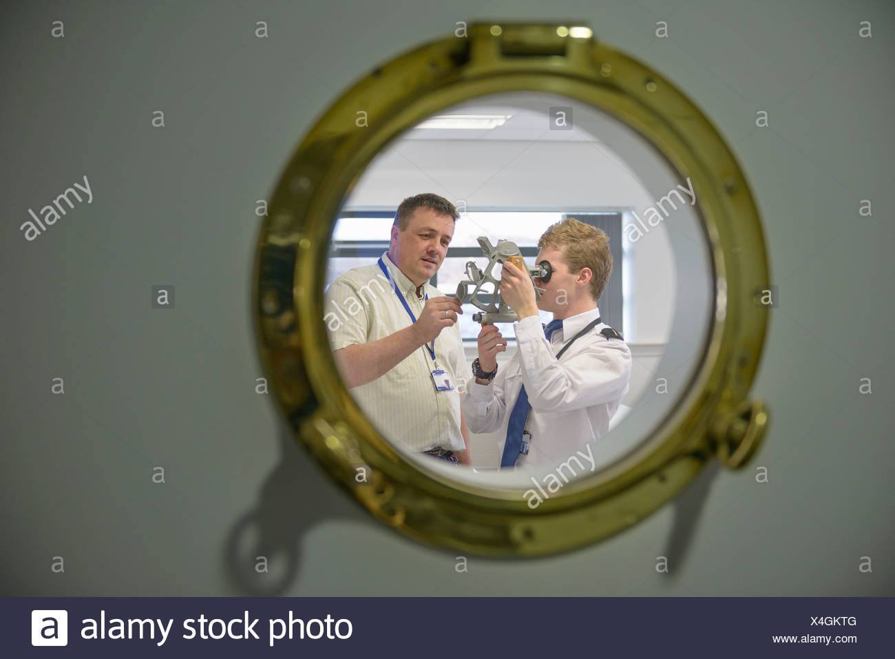Student and teacher using sextant - Stock Image