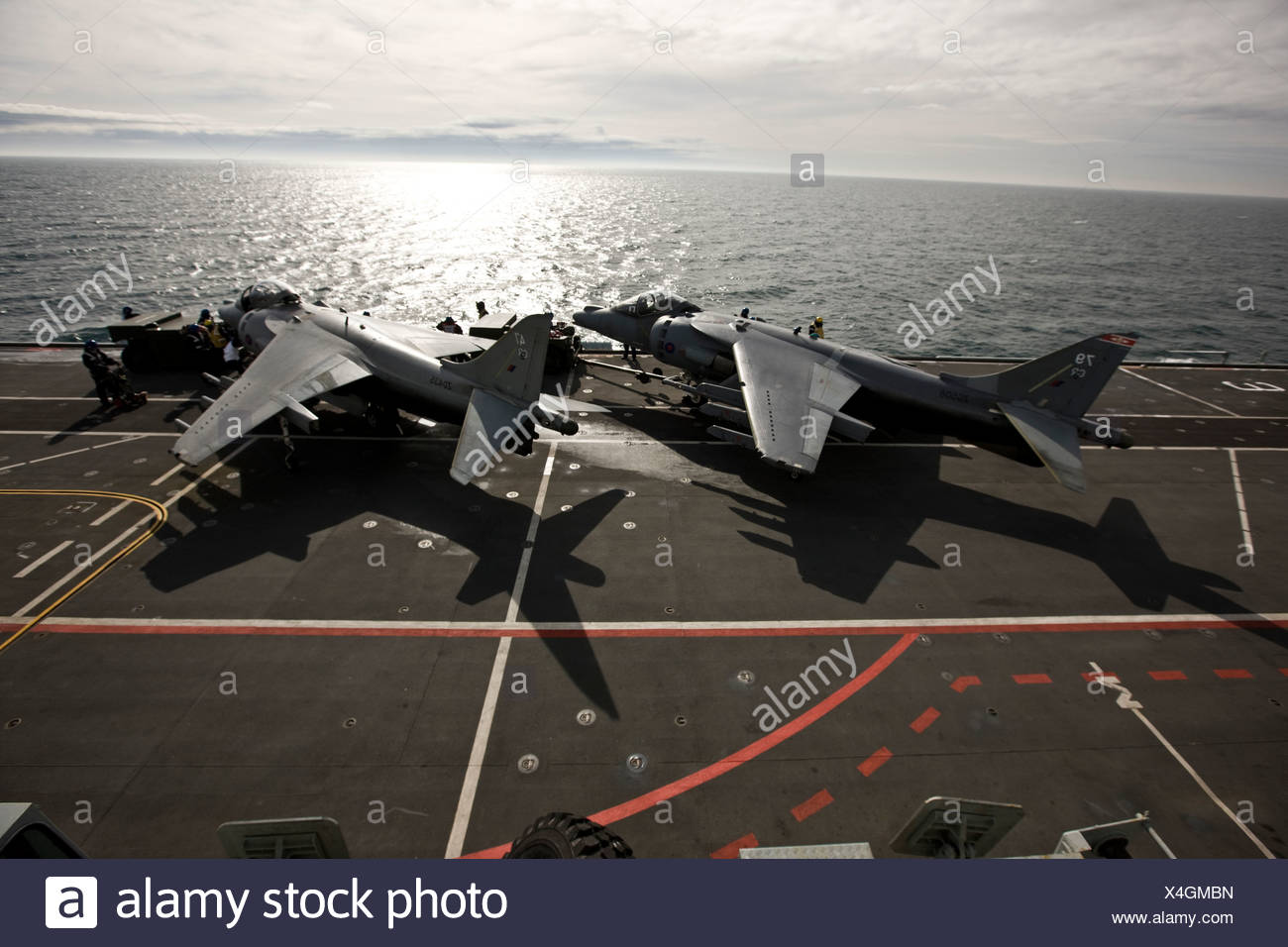 Harrier jets on naval aircraft carrier HMS Illustrius - Stock Image