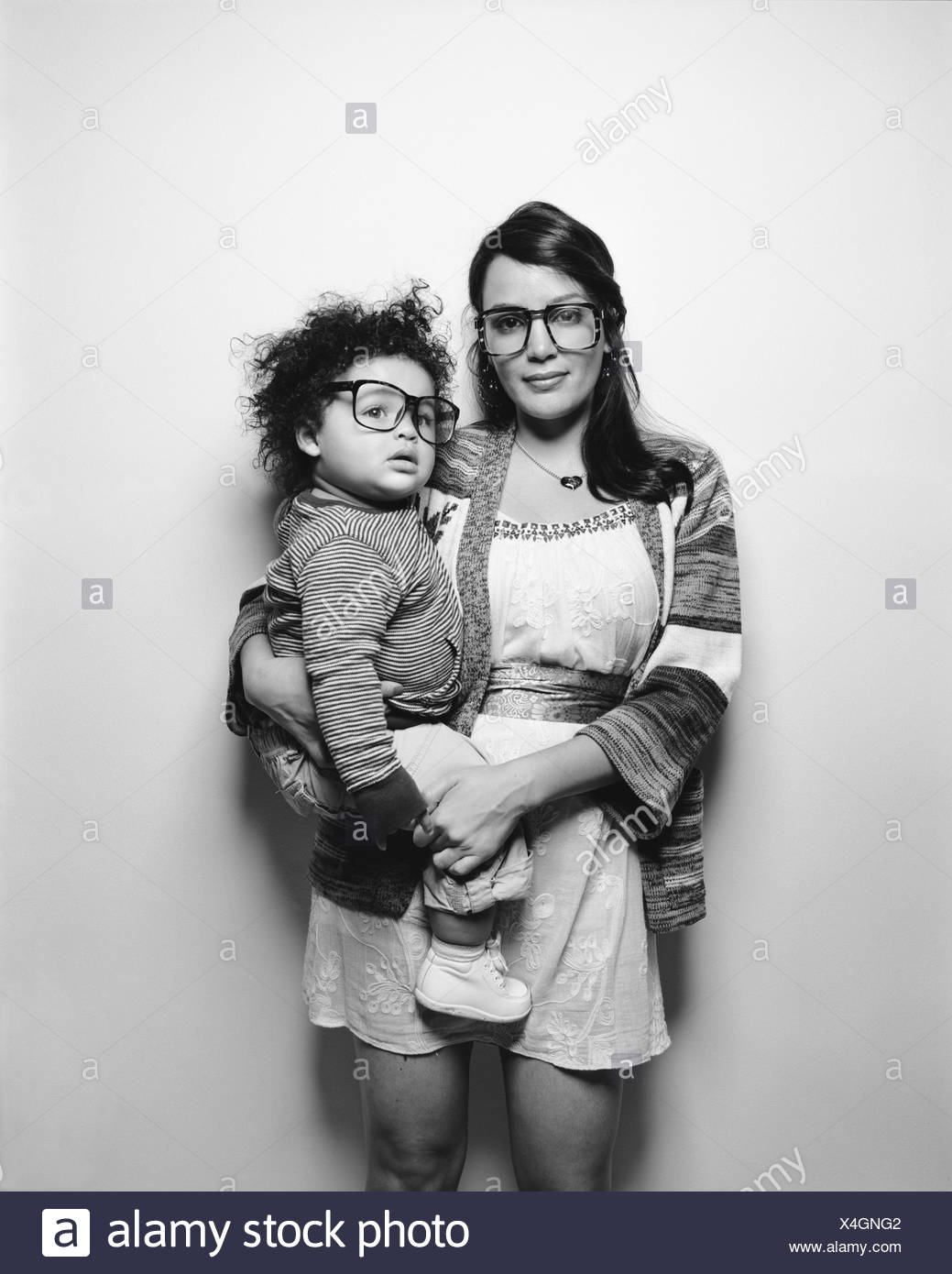 Mother and baby son wearing big glasses - Stock Image