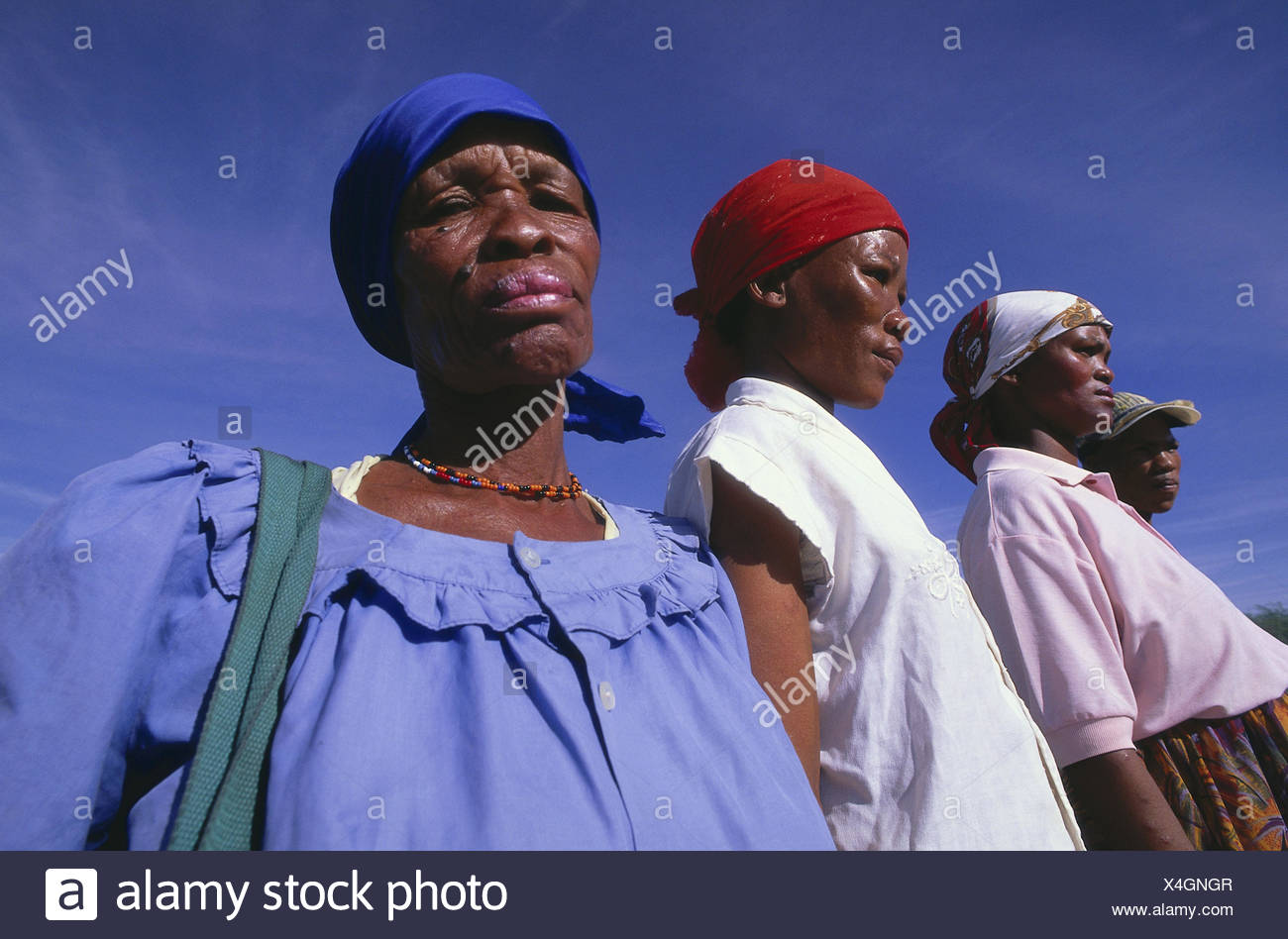 Botswana, women, portraits, clothes, brightly, clothes, headscarfs, headgear, locals, heavens, cloudless, blue, people, - Stock Image