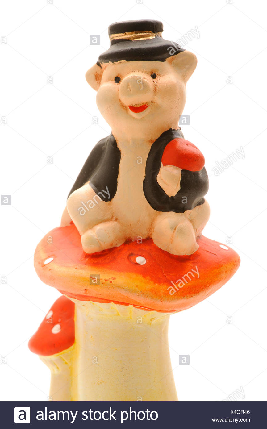 Marzipan pig sitting on a Fly Agaric - Stock Image