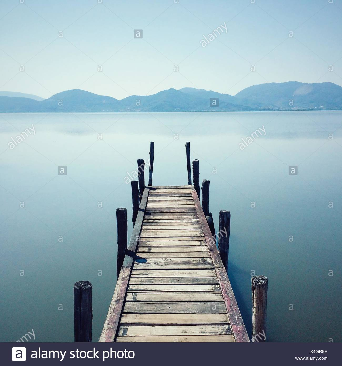 High Angle View Of Boardwalk Over River Against Clear Sky - Stock Image