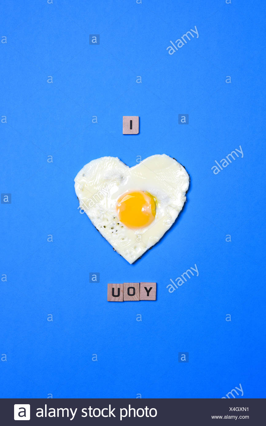 I love you written using an heart made with an egg - Stock Image