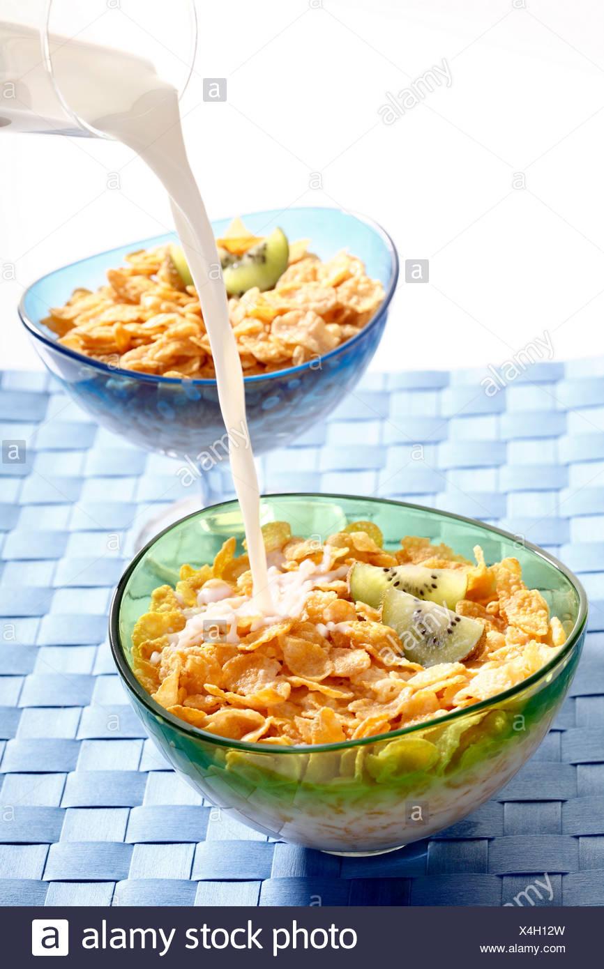 Cornflakes with kiwi, milk Stock Photo