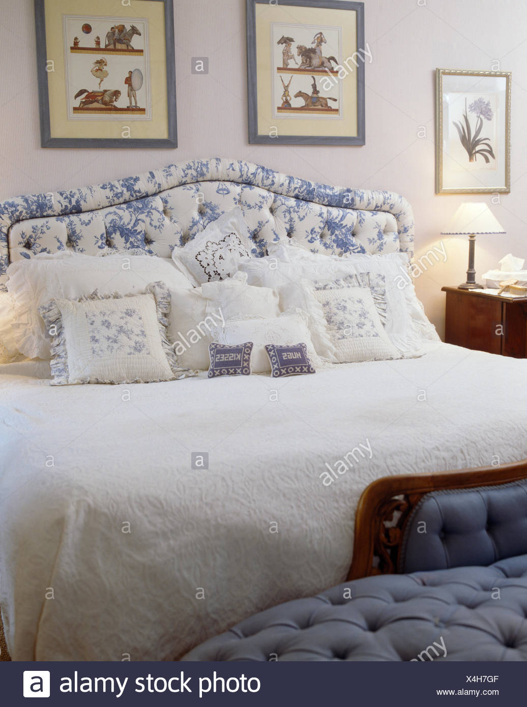 Picture of: Blue White Upholstered Headboard On Bed With White Quilt And Blue And White Cushions In Country Bedroom Stock Photo Alamy